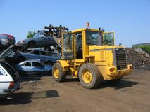 A truck lifting a car wreck. At a scrapyard in Norway stock photos