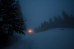 A truck with lights on winter road Stock Photography