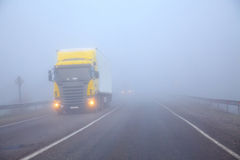 The truck on a line in a fog Stock Photo