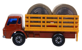 Truck loaded with coins. Toy truck loaded with coins isolated on white Stock Photo