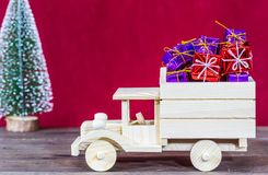 Truck loaded with gifts. Wooden truck loaded with Christmas gifts Stock Photos