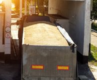 The truck loaded with grain grabs the scales, for further grain unloading, granule stock photography