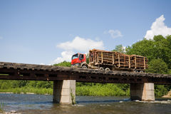 Truck loaded with logs. Forest industry. Truck loaded with logs going over the bridge Stock Image