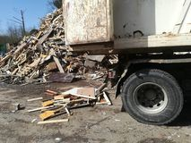 Truck loaded with recycled wood. Dump truck loaded with recycled wood in a waste plant, wasteland, landfill, scrap, wooden, environment, recycling, recycled Stock Photos
