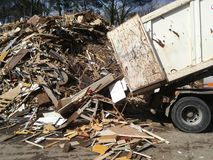 Truck loaded with recycled wood. Dump truck loaded with recycled wood in a waste plant, wasteland, landfill, scrap, wooden, environment, recycling, recycled Stock Photography