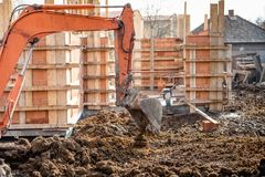 truck loader excavator moving earth and leveling a ground hole Royalty Free Stock Photography