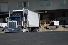 Truck loading. Semi truck at fruit warehouse being loaded Stock Photo