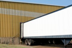 Truck in loading dock Stock Images