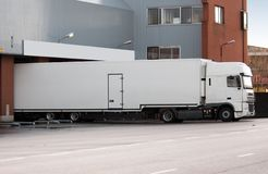Truck at loading dock Royalty Free Stock Images