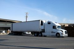 Truck at loading dock. Semi truck at fruit warehouse being loaded Royalty Free Stock Image