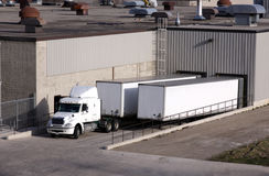 Truck Loading Dock. A transport truck getting loaded at a loading dock Stock Images