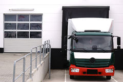 Truck at loading dock Stock Image