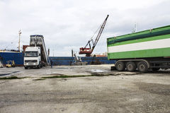 Truck loading grain on ship Royalty Free Stock Photos