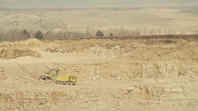 Truck loading in a quarry. Truck and excavator stock footage