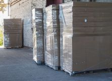 Truck loading and shipping. Stack of carton boxes on pallet ready for transport. Royalty Free Stock Image