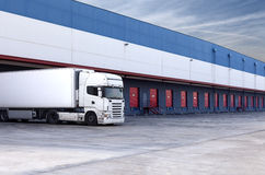 Loading truck. Truck loading at a warehouse building Stock Photos