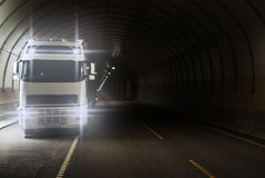 Truck in long road tunnel. Truck in a long road tunnel Stock Photos