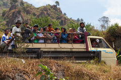 Truck with many happy people, Indonesia. DIENG PLATEAU, INDONESIA - SEP 12: Public truck transport on Sep 12, 2012  in Dieng Plateau, Central Java island Royalty Free Stock Image