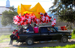 Truck with many Santa claus balloons. One truck with many balloons to be gifted throwing it to the people in the street as a tradition in mexico called the bread Stock Images