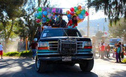 Truck with many toys and ballons. One truck with many balloons and some toys ready to be gifted throwing it to the people in the street as a tradition in mexico stock image
