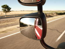 TRUCK MIRROR VIEW ON DRIVING Royalty Free Stock Photography