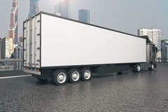 Truck on modern city background. Closeup and side view of empty black truck trailer on modern city background. Mock up, 3D Rendering Royalty Free Stock Photos