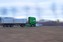 Truck in momentum. Dynamic photo of the truck at full speed Royalty Free Stock Images
