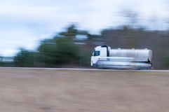 Truck in momentum. Tanker truck makes the road at high speed Stock Photos