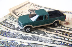 Truck with Money. Miniature truck with American currency Royalty Free Stock Photography