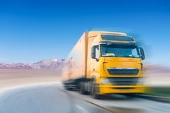 Truck motion blur on plateau Stock Images