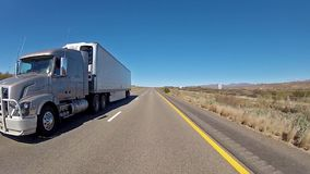 Truck in motion. Panoramic view of truck moving on freeway in Nevada, USA stock video footage