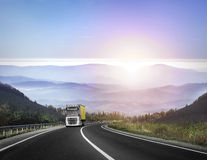 Truck on the mountain road. Truck on the mountain road at sunset Royalty Free Stock Photos