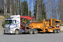 Truck Mounted Equipement for Recycling Logging Residue. SALO, FINLAND - MAY 5, 2017: Scania truck mounted equipment for recycling forestry residues parked on a Stock Photography