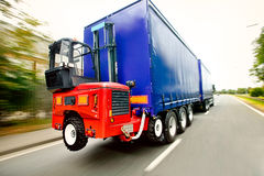 Truck Mounted Forklift. Portable Forklift Transporting Shipment on a truck royalty free stock photography