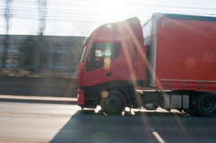 Truck on the move. Red truck on the move with motion blur Royalty Free Stock Image