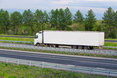Truck moves on country highway. Big truck moves on country highway Royalty Free Stock Photography