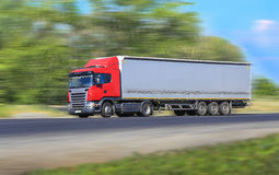 Truck moves on country highway. Big truck moves on country highway Stock Photo