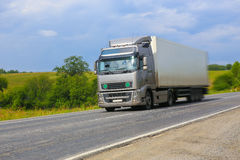 Truck moves on country highway. Big truck moves on country highway Stock Photos
