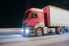 Truck moves on highway at night. Truck moves on country highway at night Royalty Free Stock Photos