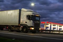 Truck moves on highway at night. Truck moves on country highway at night Stock Images