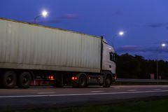 Truck moves on highway at night. Truck moves on country highway at night Royalty Free Stock Images
