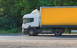 Truck moves on highway. Big truck moves on country highway Royalty Free Stock Images