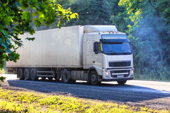 Truck moves on highway. Big truck moves on country highway Royalty Free Stock Photography