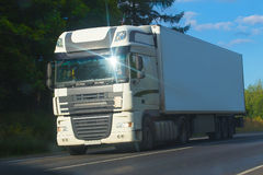 Truck moves on highway. Big truck moves on country highway Royalty Free Stock Photos