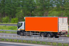 Truck moves on highway. Big truck moves on country highway Stock Photos