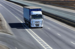 Truck moves on highway. Big powerful truck moves on highway Stock Photos