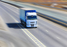 Truck moves on highway Stock Photos