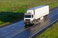 Truck moves on highway. Big powerful truck moves on highway Stock Image