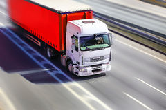Truck moves on highway. Big powerful truck moves on highway Royalty Free Stock Photo