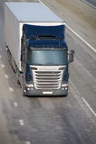 Truck moves on highway. Big powerful truck moves on highway Royalty Free Stock Images